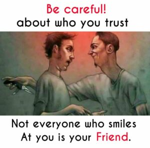 Careful about who you trust, guy smiles in friends face, same time has knife to friends back.