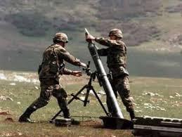 two army men loading a missile rocket gun