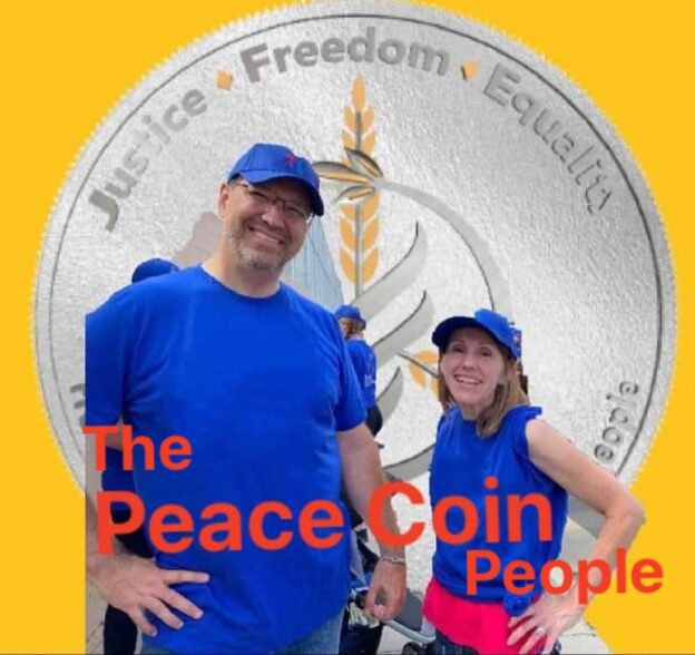 PeaceCoin people, chris and kelly Watkins in front of silver coin